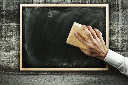chalk board being erased by hand